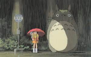 Two girls wait in the rain with their new neighbor, Totoro
